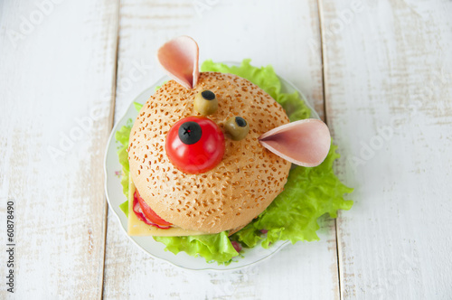 Funny sandwich for child on wooden boards