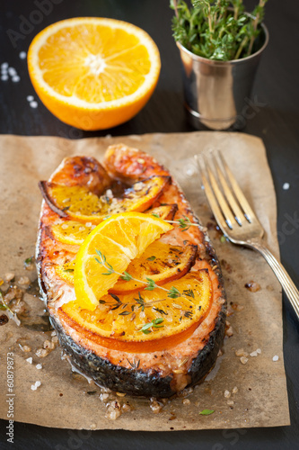 Grilled salmon with thyme on chalkboard