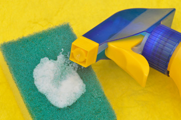 close up of cleaning bottle and sponge