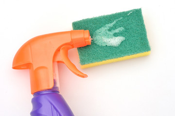 Orange spray bottle with green scourer