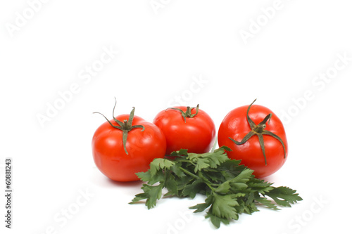 Tomatoes with parsley over white