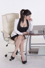 Young secretary sitting office chair using a phone