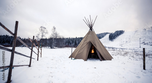 Wigwam in winter forest