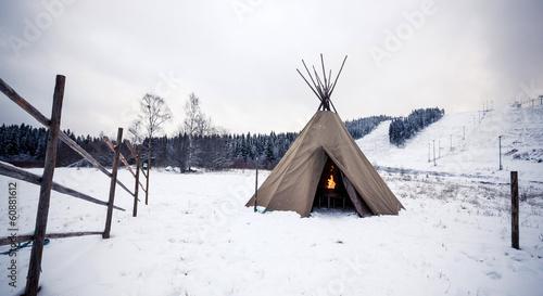 Leinwanddruck Bild Wigwam in winter forest