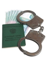 Military card of officer, handcuffs and money isolated
