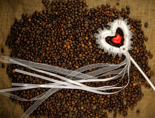 Heart with coffee beans on the sackcloth