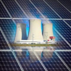Solar panels and nuclear power plant. Industrial background.