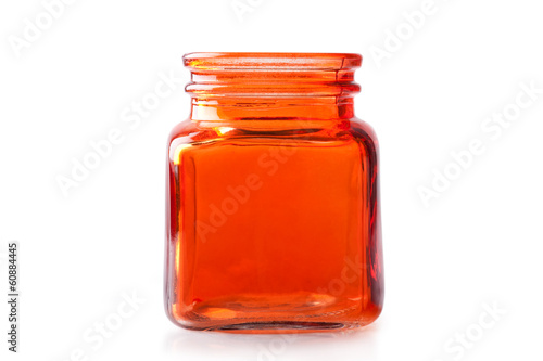 Empty orange glass jar
