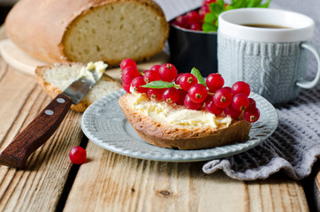 Homemade bread with butter and red currant