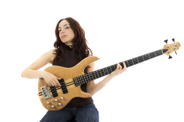 Young woman playing a bass guitar