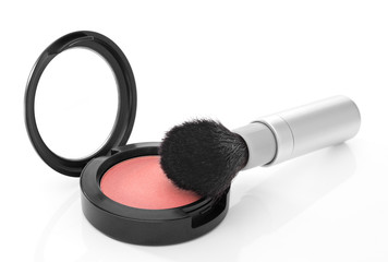 Pink blush and makeup brush on white background