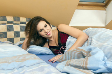 Beautiful girl in the bed