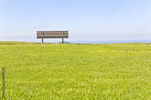 Calm place to rest and relax in park,bench,grass,and sky