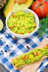 Guacamole with avocado, lime, tomato