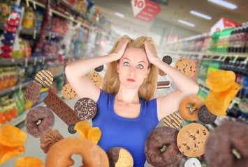 Diet Woman at Grocery Store with Junk Food