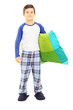 Full length portrait of boy in pajamas holding a pillow