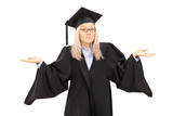 Confused young female in graduation gown