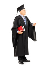 College professor in graduation gown holding books