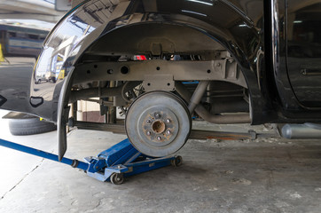 Rear drum brake assembly on car