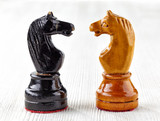Two old wooden chess pieces