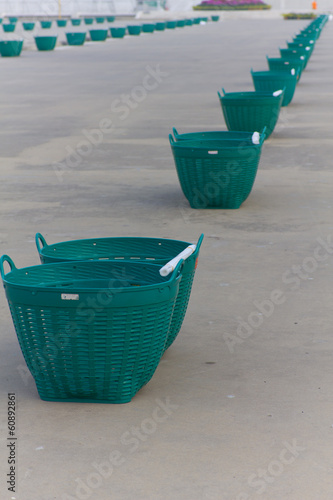 Empty plastic garbage baskets