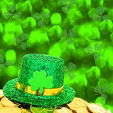 St Patricks Day hat and gold coins with green background