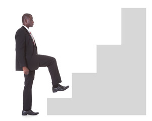 Businessman Climbing Steps