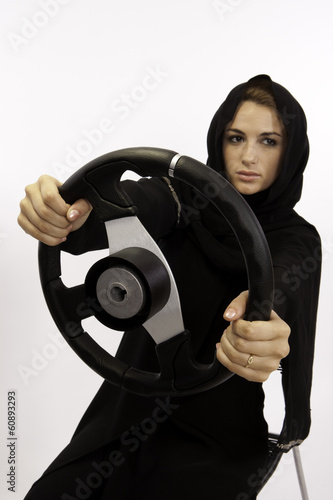 A Young Arab Woman With A Steering Wheel