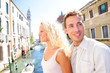 Young couple lifestyle walking in Venice