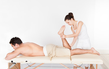 Woman Massaging Man's Foot
