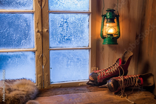 Warm cottage in a winter evening