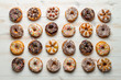 Large group of colorfully decorated donuts