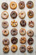 Large group of variously decorated donuts