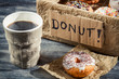Hot coffee and box with donuts