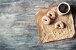 Donuts, coffee and wooden table background