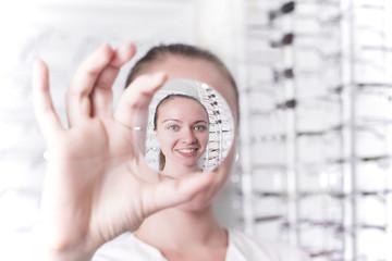 Woman looking through a lens