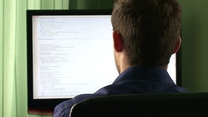 Young computer programmer at his desk