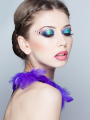 beautiful model wearing blue make-up - studio shot on grey