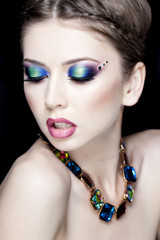 beautiful model wearing blue make-up - studio shot on black
