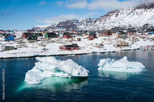 Icebergs with small town in background, North Greenland