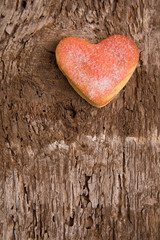 Heart shaped cookies on a wooden background