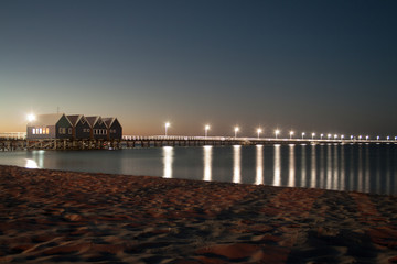 A long jetty with light posts at twilight