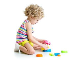little kid playing with toys