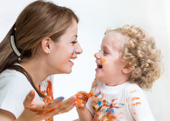 mom and kid girl painting together