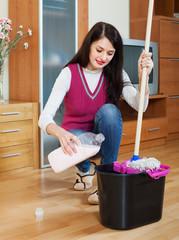 girl washing  floor with detergent