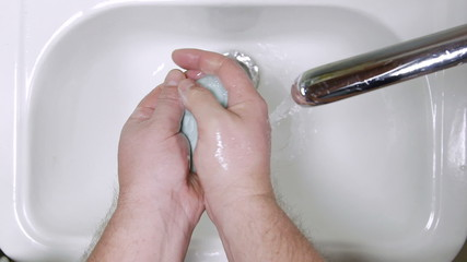 Man washing hands in bathroom
