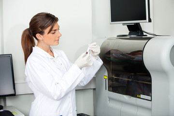Scientist Analyzing Blood Sample For Coagulation Analysis