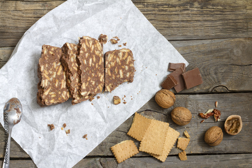 Homemade cake with chocolate nuts and biscuits