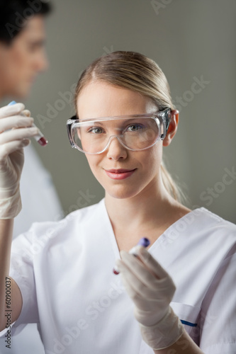 Confident Lab Technician Analyzing Blood Samples