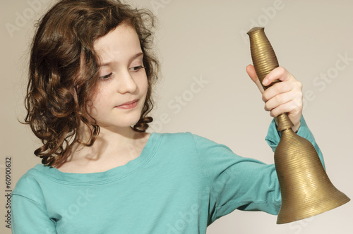 Child Rings an Old School Bell